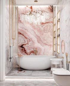 That pink marble statement wall 💕 and the Chandelier are straight out of my dreams!!! Now I'm in the mood to shop for lights! . Do you need a bit of guidance finding some fabulous lighting? Schedule a 'Two-hour design appointment! We even do long distance! Just go to: onecoastdesign.com/contact . . . . #luxurybathroom #marblebath #marble #pink #bathroomdecor #bathroomideas #whitebathroom #whitebathrooms #pinkmarble #whitemarblefloor #brassaccents #brassfixtures #brass #bathroomgoals #tile