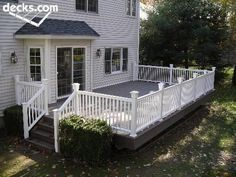 I like how this deck extends to the side of the house. I would put another set of stairs leading down the front, and I would want a pergola and maybe a second story deck off the master bdrm.