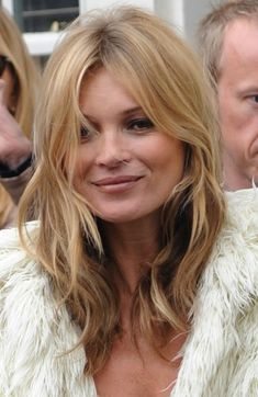 KATE MOSS's hair has a few layered slightly messy & wavey piecey strands to frame the face and neck ~ this version still hip as it has a natural and softly rough texture, and is NOT smoothly rounded and blown out ~ which would be more dated and older looking.