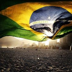 Brazilian flag against the sunset, Ipanema, Rio de Janeiro, Brazil Samba, Places To Travel, Places To Visit, Brazil Flag, Rio Brazil, Brazil World Cup, Flags Of The World, Dream Vacations, Fc Barcelona