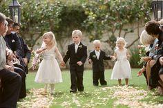 ring bearers walking the flower girls