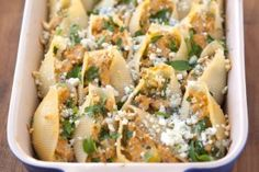 Buffalo Chicken Stuffed Shells - great app for football watching! Drizzle with ranch dressing once assembled, instead of using blue cheese