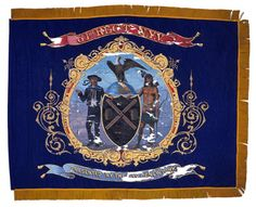 This blue silk regimental color carried by the 61st Regiment New York Volunteer Infantry features the Arms of the City of New York painted to the center with a presentation inscription on the lower ribbon. The upper ribbon includes the regiment's numeric designation.