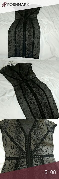 Cache dress Gray with black studs, black zipper that zips from bottom to chest in front of dress, this dress fits body like a glove, bandage material Cache Dresses
