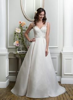 Beaded embroidered lace and organza ball gown highlighted by a v-neckline. https://www.lillianwest.com/lillian_west/6372