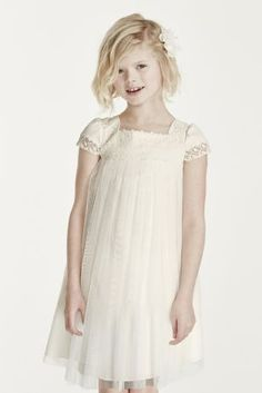 This whimsical dress will delight your smallest bridal party member!  Short sleeved empire bodice features eye catching embroidered detail on square neckline.  Tea length tulle skirt. Available in storeand online in sizes 2T-14 in Ivory and White. Fully lined. Zipper back. Imported. Dry clean only.