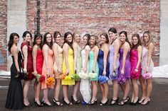 rainbow bridesmaids with matching bouquets. I seriously love this.