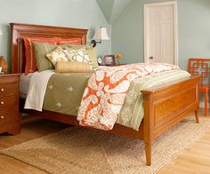 Ok, so definitely don't like the green bedspread, but the coral/orange could be great with my aqua wall.
