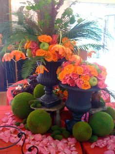 What I like about this bright centerpieces is the use of the moss spheres