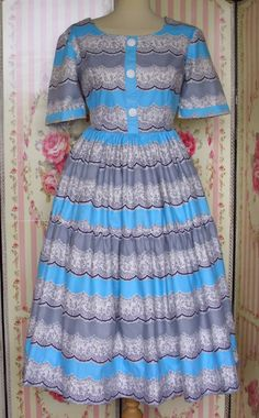 http://www.rainbowvalleyvintage.co.uk/rainbowvalleyvintageshop/prod_915774-Vintage-1950s-Homemade-Cotton-Novelty-Print-Dress-Size-14.html