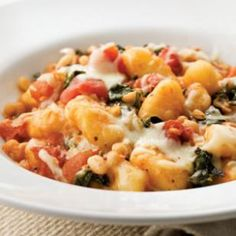 Skillet Gnocchi with Chard & White Beans. This is an easy and delicious dish! I serve with Al Fresco all-natural chicken sausages. (http://www.eatingwell.com/recipes/skillet_gnocchi_with_chard_white_beans.html)
