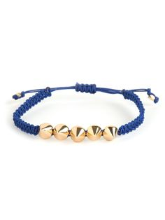 We love this rendition on the classic wrap bracelet. It features a cool and crafty braided strand thats accented with a set of spikes cast in glam gold or silver.