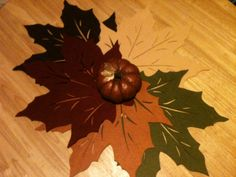 5 felt leaf placemats from bed, bath and beyond ($1 each) combined make a great centerpiece mat.