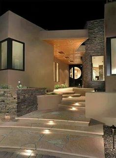 Classy entry way. Pavers, lights, sandstone, stone tiles