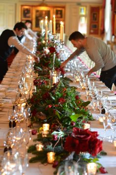 Goodwood House, Ballroom.  One table, lots of candles, roses, amaryllis, blue pine, cones and snow.