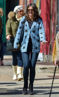 Katie Holmes is seen strolling with a friend.
