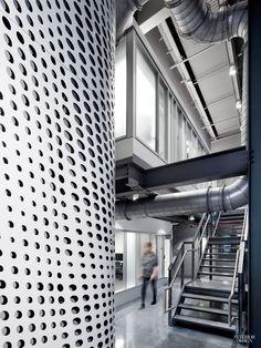 Jack Esterson Designs Film and Video Department for Pratt. In the film and video department at Pratt Institute, CNC-cut aluminum wraps a corner of the screening room