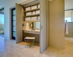 I want a 10  inch deep cabinet with a hidden vanity. This one has closet type doors which may be less expensive than cupboard doors. I also like that the vanity chair can be tucked away as I don't have as much space. Maybe we can do mirrored doors to make it feel more spacious too.