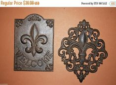 1 set of 2 Fleur De Lis, Combo Sign, plaque, cast iron, FREE SHIPPING! Description You are buying 2 solid cast iron, wall plaques. Old world charm with Fleur De Lis designs. Free Shipping! Size: Welcome plaque is approx. 6 x 9. Diamond shaped lacy Fleur De Lis plaque is approx. 8 x 9