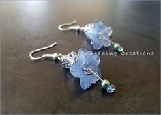 Acrylic Lucite Flower and Crystal Handmade Earrings available at: http://www.bidorbuy.co.za/item/241598730/EARRINGS_ACRYLIC_LUCITE_AND_CRYSTALS_SILVER_AND_BLUE.html