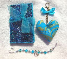 Hey, I found this really awesome Etsy listing at https://www.etsy.com/listing/185085103/crystal-blue-fantasy-gift-set-beaded #etsy #gifts #heart #notebook #glitter #bracelet