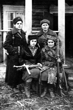 gunsandposes:  Jewish partisans during World War II. That is photographer Faye Schulman on the bottom right. (via)