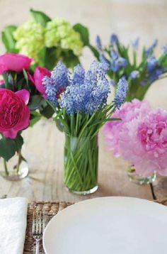 Entertaining tips from Ina Garten- Deconstructed bouquets with one type of flower in each small vase.