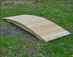 """3' White Cedar Unstained Arched Plank Bridge by Fifthroom. $199.00. Hardware: stainless steel screws and galvanized washers, nuts, and bolts. Made in the USA. Free Shipping. Protected by 5 year limited warranty. 3'L x 15""""W; max span of 20""""; capacity: 300 lbs. Our Unstained Arched Plank Bridge is a shining example of the beauty of sheer simplicity. We simply start with the finest white cedar, and then fashion it, by hand, into this attractive, practical, durable, garden bridge..."""