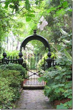 secret garden, gate, herringbone brick, arch, wrought iron
