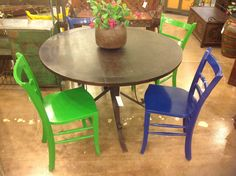 Add a little color to your garden with the Portola round table (48 x 48 x 36) and the Sonoma iron chairs.