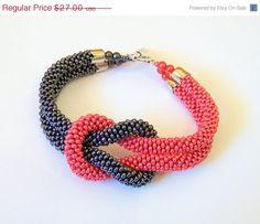 CIJ SALE SALE - Beadwork - Bead Crochet Bracelet in grey and red - Beaded Bracelet - Infinity Knot Bracelet - Beaded Bracelet Cuff via Etsy