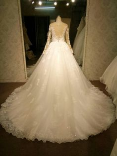 Most of the sheer long sleeve traditional lace wedding gowns are modest in appearance. You can modify any Darius design to your liking.