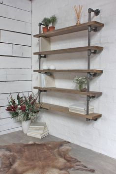 reclaimed scaffolding and dark steel pipe shelving by inspirit | notonthehighstreet.com