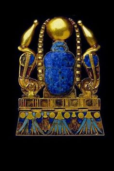 Ancient Egyptian jewel The cobras of protection on each side wearing the crown of Upper Egypt; the lotus & suns on bottom edge represent immortality; the lapis lazuli representative of the sky & stars; the turquoise is for long life; the carnelian for protection. The shen is for immortality & protection; the crook represents power. The square is the earth & the 3 bars are for the cycle of birth, death & rebirth.The scarab sits atop the mountain or afterlife. ~ETS #ancientegypt #jewelry…