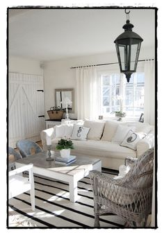 Shabby chic white, stripes, and wicker.