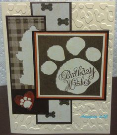 """SC443, Embossed the vanilla CS with a Cuttlebug folder and placed one panel with a brown plaid bg and fire-hydrant image. The other DP, a dogs favorite - bones!! Both panels are set on shades of brown bg CS.  The large paw image was cut from dp and bordered with vanilla, rust, and dark brown CS. Final touch - stamped, """"Birthday Wishes"""" inside the paw!    Card is now ready for that special friend in your life that loves dogs!!  TFL!"""