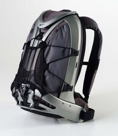 Wear it well. (The Nike Epic Sportpack was designed with the mobile athlete in mind. A hard exoskeleton linked by urethane flex points protects mobile devices while flexing with the body). Nike Design, Bag Design, Motorcycle Backpacks, Fashion Bags, Mens Fashion, Nike Bags, Cool Backpacks, Teen Backpacks, Leather Backpacks