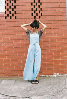 CAVES COLLECT long wrap overalls in powder blue linen.