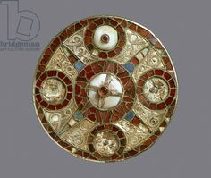 Jewelled disc brooch, from Grave 3 at Monkton, Kent, Anglo-Saxon (gold with garnets and shell)