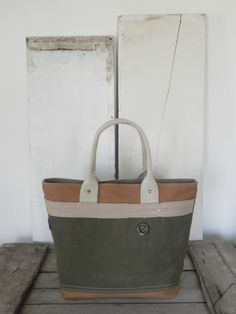 Tote bag made from WWII era US military canvas, dead stock canvas, and two upcycled belts, A Well Worn Story