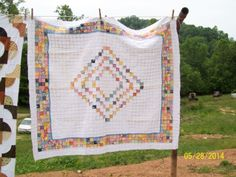 Postage Stamp baby quilt made with the 1930's reprints fabrics.