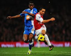 Theo Walcott (R) of Arsenal holds off the challenge of Maynor Figueroa (L) of Wigan Athleticduring the Barclays Premier League match between Arsenal and Wigan Athletic at the Emirates Stadium on January 22, 2011 in London, England.