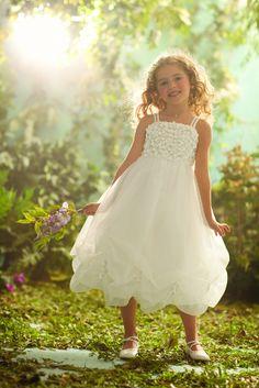 Blossom Rapunzel~ Tea length, taffeta and organza dress features crystal beading, pearls and taffeta flowers.