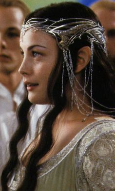 - Lord of the Rings Half-Elven and full babe, Liv Tyler as Arwen in Lord of the Rings is the ultimate in ethereal bohemian inspiration. Her dewy skin and Rapunzel-esque waves left me totally inspired—and reaching for a face mask and a bottle of biotin… Liv Tyler, Lord Of Rings, Fellowship Of The Ring, Arwen Costume, Arwen Undomiel, Aragorn, Arwen Lotr, Tauriel, Legolas
