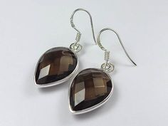 Fabulous sterling silver smoky quartz earrings. Tear drop design sterling silver earrings with faceted smoky quartz stone and fine details throughout.