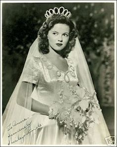 Shirley Temple     September 19, 1945    Astoundingly popular child star Shirley Temple married for the first time when she was 17 years old. The bride wore a traditionally styled satin wedding gown, while groom John Agar—just weeks after the end of the war—was in military uniform.