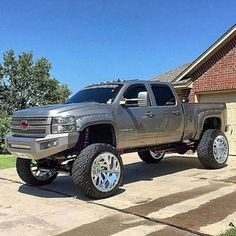 Wicked lifted Duramax  with custom offset rims