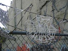 Invasive crochet: Lace doilies and razor wire street art New York installation crochet
