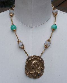 Unique hadncrafted vintage repurposed eco friendly art nouveau buckle necklace. For sale $50.  Use coupon code PINT10 and receive 10% off your order. https://www.etsy.com/listing/212057978/art-nouveau-necklace-peking-green-glass?ref=shop_home_active_1