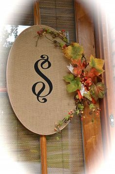 Front Porch - Monogrammed Burlap Wreaths. Large oval shaped embroidery hoop (turned on side). Note to self: try stencil, cut out felt, or something to either paint, glue on, or embroider the initial the easiest way onto the burlap the way I want it. Take fall leaves, berries, etc to cover tightener for hoop on side.